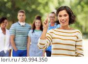 Купить «happy woman showing one finger or pointing up», фото № 30994350, снято 6 марта 2019 г. (c) Syda Productions / Фотобанк Лори
