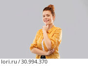 Купить «smiling red haired teenage girl in checkered shirt», фото № 30994370, снято 28 февраля 2019 г. (c) Syda Productions / Фотобанк Лори