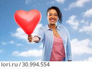 Купить «african american woman with heart-shaped balloon», фото № 30994554, снято 2 марта 2019 г. (c) Syda Productions / Фотобанк Лори