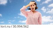Купить «confused young woman in pajama over sky», фото № 30994562, снято 6 марта 2019 г. (c) Syda Productions / Фотобанк Лори