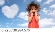 Купить «surprised little african american girl over sky», фото № 30994570, снято 9 марта 2019 г. (c) Syda Productions / Фотобанк Лори