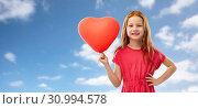 Купить «happy red girl with heart shaped balloon over sky», фото № 30994578, снято 9 марта 2019 г. (c) Syda Productions / Фотобанк Лори
