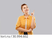 Купить «red haired teenage girl pointing finger up», фото № 30994602, снято 28 февраля 2019 г. (c) Syda Productions / Фотобанк Лори