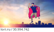 Купить «man in superhero cape flying over sunset in city», фото № 30994742, снято 3 февраля 2019 г. (c) Syda Productions / Фотобанк Лори