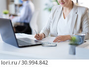 Купить «businesswoman with papers working at office», фото № 30994842, снято 28 марта 2018 г. (c) Syda Productions / Фотобанк Лори
