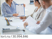 Купить «business team discussing report at office», фото № 30994846, снято 28 марта 2018 г. (c) Syda Productions / Фотобанк Лори