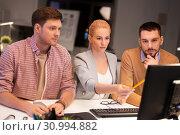 Купить «business team with computer working late at office», фото № 30994882, снято 26 ноября 2017 г. (c) Syda Productions / Фотобанк Лори