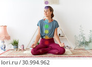 Купить «woman meditating in lotus pose at yoga studio», фото № 30994962, снято 21 июня 2018 г. (c) Syda Productions / Фотобанк Лори
