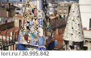 Купить «Palau Guell roof with chimneys turned by architect Antoni Gaudi into sculptures», видеоролик № 30995842, снято 2 сентября 2018 г. (c) Яков Филимонов / Фотобанк Лори