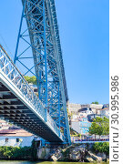 Fragment of famous steel bridge dom Luis above connects Old town Porto with Vila Nova de Gaia at river Douro, Portugal (2018 год). Редакционное фото, фотограф Николай Коржов / Фотобанк Лори