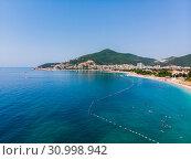 Купить «Aerial view of long coastline of Budva city, Montenegro. Balkans, Adriatic sea, Europe», фото № 30998942, снято 12 июня 2019 г. (c) Володина Ольга / Фотобанк Лори