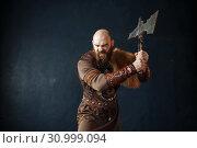 Купить «Angry viking with axe, barbarian image», фото № 30999094, снято 27 марта 2019 г. (c) Tryapitsyn Sergiy / Фотобанк Лори