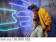 Купить «Black rapper in underpass neon light on background», фото № 30999182, снято 5 апреля 2019 г. (c) Tryapitsyn Sergiy / Фотобанк Лори
