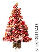 Купить «Christmas tree made of sausage on a background of a wooden wall», фото № 30999218, снято 6 апреля 2019 г. (c) Татьяна Яцевич / Фотобанк Лори