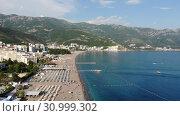 Купить «Becici, Montenegro - June 12.2019. Beautiful top view of the beach with people.», видеоролик № 30999302, снято 17 октября 2019 г. (c) Володина Ольга / Фотобанк Лори