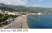 Купить «Becici, Montenegro - June 12.2019. Beautiful top view of the beach with people.», видеоролик № 30999310, снято 17 октября 2019 г. (c) Володина Ольга / Фотобанк Лори