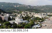 Купить «Becici, Montenegro - June 11.2019. View of hotels in popular resort village of Becici», видеоролик № 30999314, снято 18 августа 2019 г. (c) Володина Ольга / Фотобанк Лори