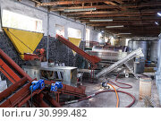 Купить «Machines for grape destemmer and crushing for wine production on the plant Kindzmarauli Corporation», фото № 30999482, снято 1 октября 2018 г. (c) Юлия Бабкина / Фотобанк Лори