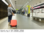 Купить «Back view of girl walking at subway with suitcase», фото № 31000258, снято 27 апреля 2018 г. (c) Яков Филимонов / Фотобанк Лори