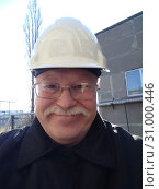 Portrait of a middle-aged man in a working suit and a work helmet. Стоковое фото, фотограф Дмитрий Морозов / Фотобанк Лори