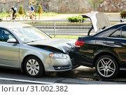 Купить «car crash accident on street. damaged automobiles», фото № 31002382, снято 17 июня 2019 г. (c) Дмитрий Калиновский / Фотобанк Лори