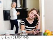 Купить «Pensive woman using smartphone», фото № 31004046, снято 2 марта 2019 г. (c) Яков Филимонов / Фотобанк Лори