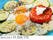 Купить «Image of fried eggs with zucchini and tomato», фото № 31004170, снято 18 июля 2019 г. (c) Яков Филимонов / Фотобанк Лори