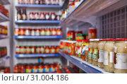 Купить «Different pickle goods at shelves in food store», фото № 31004186, снято 11 апреля 2018 г. (c) Яков Филимонов / Фотобанк Лори