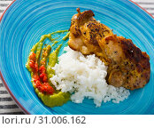 Купить «Close up of tasty rice with chicken thighs and sauces at plate», фото № 31006162, снято 21 июля 2019 г. (c) Яков Филимонов / Фотобанк Лори