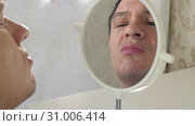 Man with pimples in a front of mirror. Стоковое видео, видеограф Илья Шаматура / Фотобанк Лори