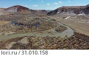 Купить «Time Lapse Video from a drone flying along valley of the Chuya river in Spring season. Altai, Siberia, Russia.», видеоролик № 31010158, снято 2 июня 2019 г. (c) Serg Zastavkin / Фотобанк Лори