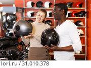 Купить «couple choosing motorcycle accessories and riding gear», фото № 31010378, снято 16 января 2019 г. (c) Яков Филимонов / Фотобанк Лори