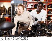 Купить «couple in motorcycle shop choosing new vehicle», фото № 31010386, снято 16 января 2019 г. (c) Яков Филимонов / Фотобанк Лори