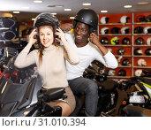 Delighted couple laughing sitting on bike. Стоковое фото, фотограф Яков Филимонов / Фотобанк Лори