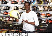 Купить «Portrait of young Afro man satisfied with new riding gear at motorcycle shop», фото № 31010402, снято 16 января 2019 г. (c) Яков Филимонов / Фотобанк Лори