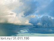 Купить «Blue dramatic colorful clouds lit by evening sunshine», фото № 31011190, снято 31 августа 2015 г. (c) Зезелина Марина / Фотобанк Лори
