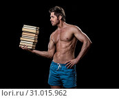 Knowledge is power concept, strong muscular man holding stack of books. Стоковое фото, фотограф YAY Micro / easy Fotostock / Фотобанк Лори