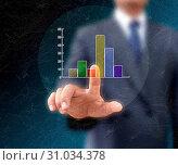 Купить «Graphs on the hands of businessmen.», фото № 31034378, снято 13 апреля 2013 г. (c) easy Fotostock / Фотобанк Лори