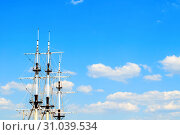 Travel landscape - ship masts with rigging on the background of the blue summer sky. Concept of sea travel. Стоковое фото, фотограф Зезелина Марина / Фотобанк Лори