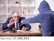 Купить «Young mobster threatening old judge», фото № 31040854, снято 23 апреля 2019 г. (c) Elnur / Фотобанк Лори