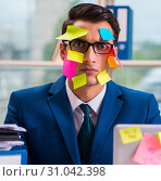 Купить «Businessman with reminder notes in multitasking concept», фото № 31042398, снято 26 сентября 2017 г. (c) Elnur / Фотобанк Лори