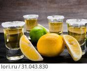 Купить «Tequila drink served in glasses with lime and salt», фото № 31043830, снято 18 сентября 2017 г. (c) Elnur / Фотобанк Лори
