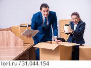 Купить «Two employees being fired from their work», фото № 31044154, снято 1 апреля 2019 г. (c) Elnur / Фотобанк Лори