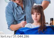 Купить «Man male hairdresser doing haircut for woman», фото № 31044286, снято 27 ноября 2017 г. (c) Elnur / Фотобанк Лори