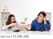 Купить «Young couple in budget planning concept», фото № 31045246, снято 22 января 2019 г. (c) Elnur / Фотобанк Лори
