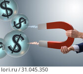 Купить «Businessman catching dollars on horseshoe magnet», фото № 31045350, снято 17 февраля 2020 г. (c) Elnur / Фотобанк Лори
