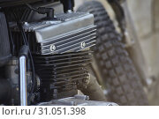Купить «Detail of the head, the engine body, the crankcase, and other various mechanical components of a four-stroke petrol engine belonging to an old vintage motorcycle.», фото № 31051398, снято 28 июля 2018 г. (c) easy Fotostock / Фотобанк Лори