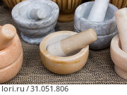 Wooden mortars and pestles as a traditional kitchenware. Стоковое фото, фотограф YAY Micro / easy Fotostock / Фотобанк Лори
