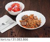 Купить «Rice with Vegetables and Meat in a plate on wooden table», фото № 31083866, снято 10 июня 2019 г. (c) Алексей Кокорин / Фотобанк Лори