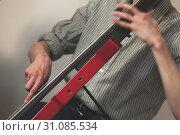 Купить «Red modern electric contrabass», фото № 31085534, снято 18 мая 2019 г. (c) EugeneSergeev / Фотобанк Лори